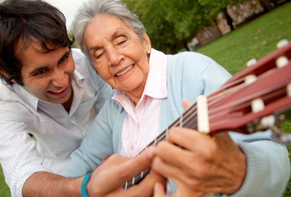 Caregiver and Client playing Guitar